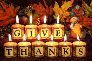 Give-Thanks-Candles-with-Cute-Pilgrim-iStock-000017351486Large