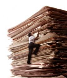 climbing-a-pile-of-files-iStock-000004145220XSmall_thumb