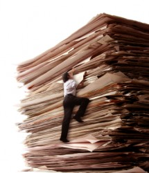 climbing-a-pile-of-files-iStock-000004145220XSmall_thumb
